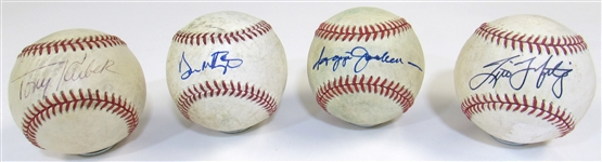 Lot of 4 N.Y. Yankees Single Signed Balls (Reggie Jackson, Mattingly, T.Martinez, & T. Kubek)