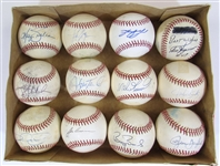Lot of 12 Single Signed Balls Featuring (Canseco, Baines, Bonds, Tartabull, ETC)
